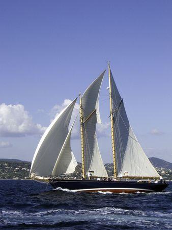 upcoming: Classic sailing yacht full and by in an upcoming mistral