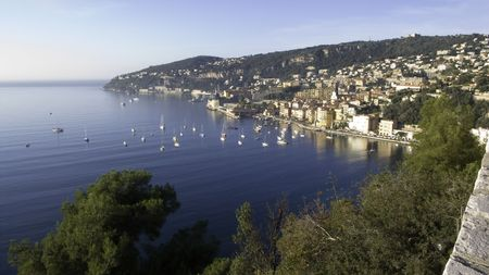 villefranche sur mer: Anchoring Bay of Villefranche sur Mer with view of the old town on a calm autumn day
