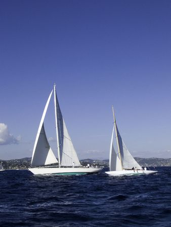 contender: Modern sailing yacht Annagine a 23 meter 2004 traditional build maxi passing a contender Stock Photo