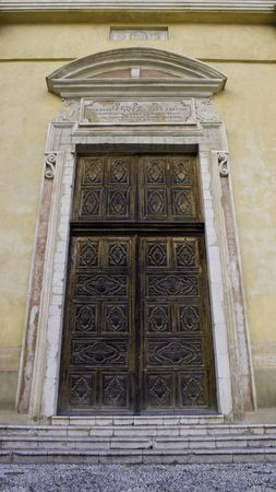 chiseled: old wooden chiseled double door of an old village cathedral in sospel Stock Photo