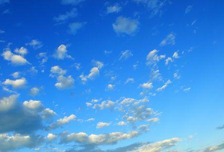 azur: Mediterranean azur sky with floating white clouds