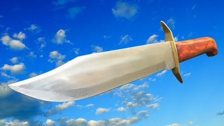Free standing bowie knife on a cloudy sky background. clipping Stock Photo - 675265