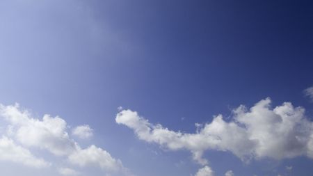 vacance: Blue mediteranean sky with white clouds Stock Photo