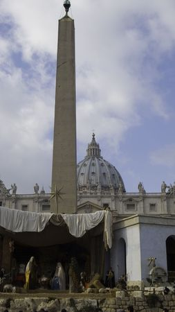 Christmas stall on St Peter square with the Vatican dome behind
