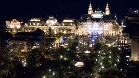carlo: Aerial night view of the Casino square in Monte Carlo Monaco and the park and gardens