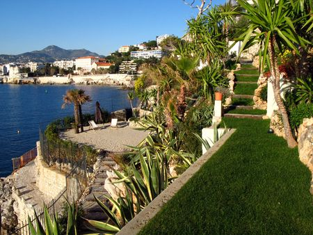 terraced garden with pool of a waterfront villa on the French riviera photo