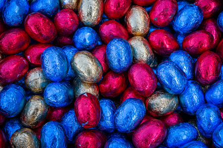Colored and wrapped chocolate Easter eggs