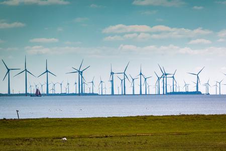 windmills in the lake called IJsselmeer, picture tasks in the Netherlands region Gaasterland, province of Friesland