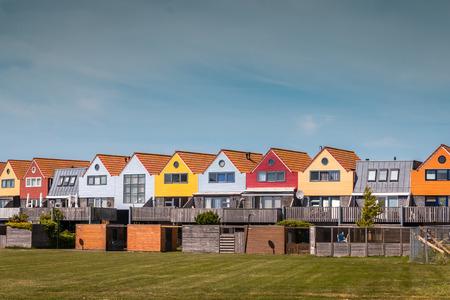 Beautiful colored houses in Stavoren at the IJssellake, Gaasterland region, Friesland province