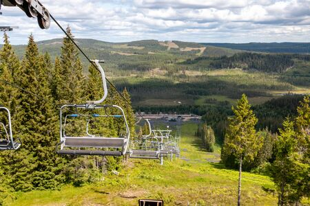 Ski area at the Safsen Dalarna resort region in Sweden, view on the chairlift and the valley