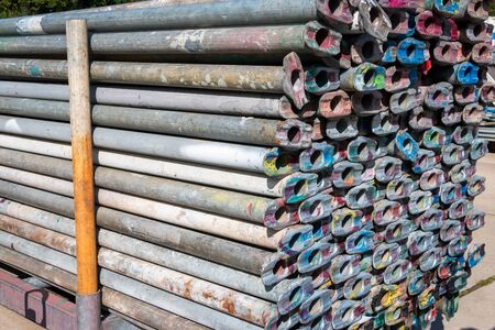 Scaffolding pipes piled up in a storage and ready for use to build a new industrial construction, picture tasks in the Netherlands 스톡 콘텐츠