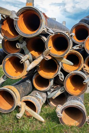 source drainage tubes piled up and normally in use for transportation or ground water to make sure the working well stays dry Stockfoto