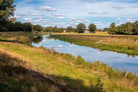 """Beautiful river view at the Regge, a river in the province of Overijssel in the nature reserve """"the Vechtdal"""" nearby Ommen"""