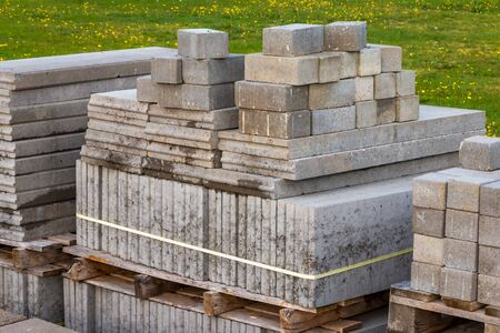 Stacked pavement stones and flagstones in gray colors on a wooden pallet