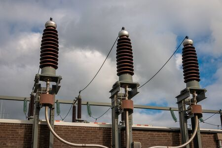Picture of a high voltage system with ceramic insulators high voltage in sight at a transformer building to reduce high voltage from 110000 volts to 10000 volts