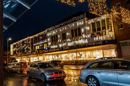 Christmas fair in the evening with lots of yellow colored Christmas lights at the buildings in the city Nordhorn country Germany Stock Photo
