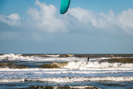 Kite surfing in wintertime on the North Sea near Hoek van Holland in the Netherlands, on a cold and windy day