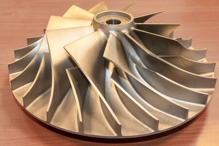 Impeller from a centrifugal compressor, disassembled and rejected due to quality requirements