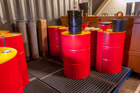 Industrial storage of oil barrels in a factory space, specially equipped for chemical waste, the Netherlands