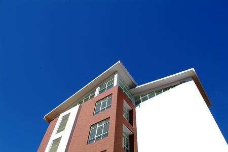 reside: campus building under deep blue sky