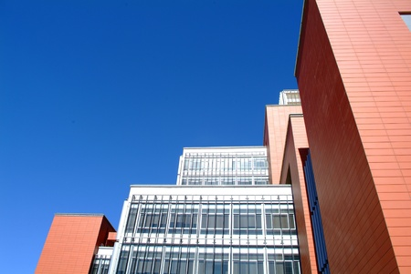 dwell: campus building under deep blue sky