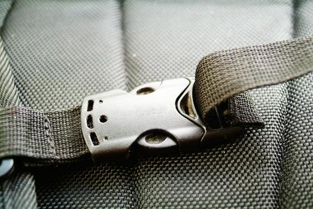 buckle: Black plastic buckle on strap