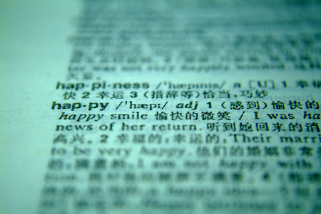 data dictionary: The word happy in a dictionary . Stock Photo