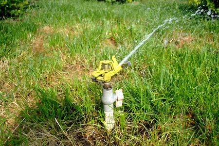 water sprinkler: Water sprinkler in garden Stock Photo