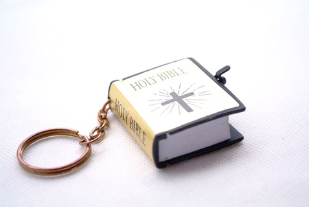 anointed: bible in white background.