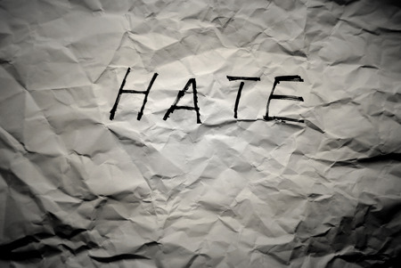 hate: wrinkle paper write hate Stock Photo