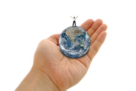 Hand holding a globe with man