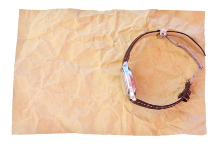 crimp: Watch on  Crumpled brown paper Stock Photo