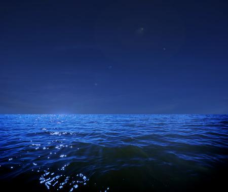 這是一個深藍色的月光下的大海的照片插圖在晚上平靜無波將使任何沿海地區或度假的偉大的旅行背景。 版權商用圖片