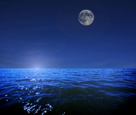glistening: Full moon above the sea at night