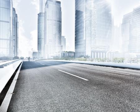 city background: Asphalt road and city Stock Photo