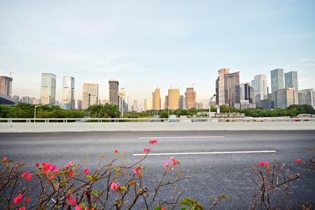 Asphalt road and city landscape view