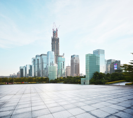 raod: empty square and city skyline