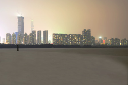 nightscape: Nightscape modern city beside sea beach in shenzhen china