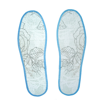 insoles: New insoles for shoes on white background Stock Photo