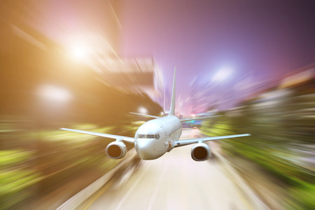 passenger jet plane flying above urban scene use for aircraft transportation and traveling business background Stock Photo