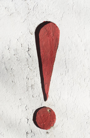 red exclamation mark pasted on the wall