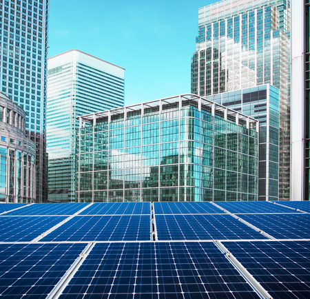 Solar panel and city 스톡 콘텐츠