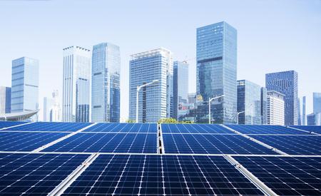 Solar panel and city 免版税图像