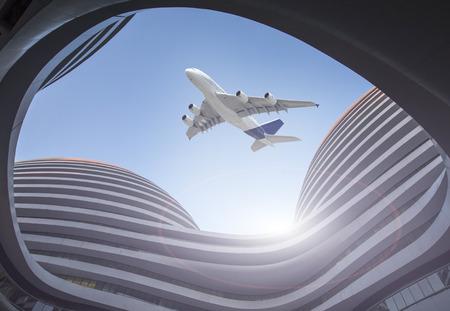 Bâtiment moderne en verre, avion au-dessus