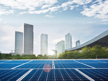 Solar panel and city Stock Photo