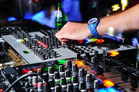 night club: dj hand and control panel
