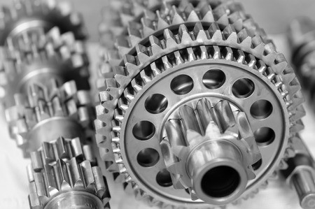 interlocked: Partial view of gears in a machine black & white