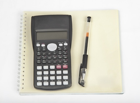 pen calculator and note pad photo