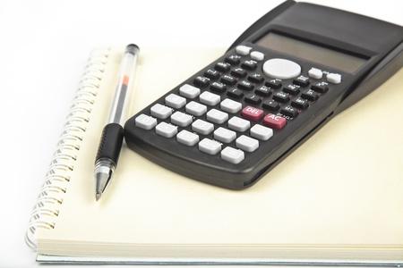 note book: calculator with pen and note book Archivio Fotografico