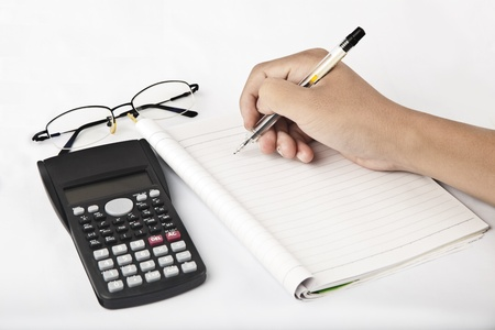 calculator with hand writing in note book photo